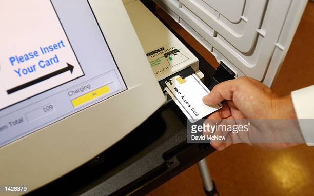 An access card is used to begin the voting process on an AccuVoteTS electronic machine during a demonstration at Leisure World retirement community...