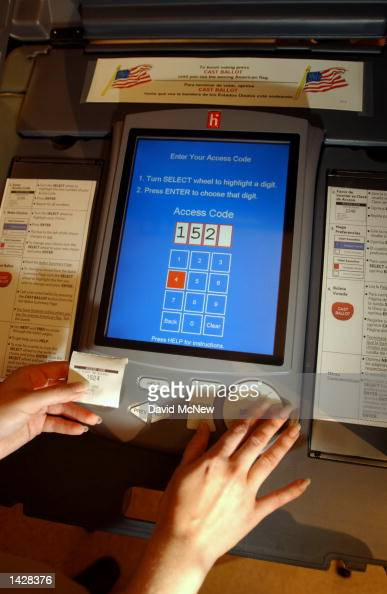 An access code printout is used to start the voting process on eSlate electronic machine during a demonstration at Leisure World retirement community...