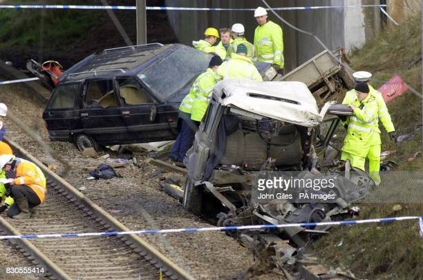 An accident investigator removing a briefcase from the smashed up Landrover that caused the Selby rail disaster in which 13 people perished *...