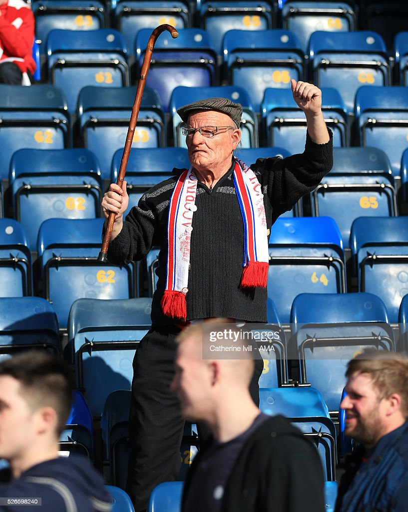 An Accrington Stanley fan dressed as an elderly man holds his walking stick in the air during the Sky Bet League Two match between Wycombe Wanderers and Accrington Stanley at Adams Park on April 30, 2016 in High Wycombe, England.