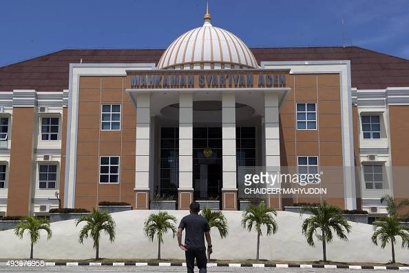 An Acehnese man walks towards the Sharia court in Banda Aceh on October 22 2015 Gay people caught having sex in Indonesia's staunchly Islamic Aceh...