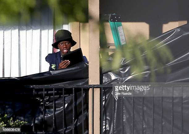An Acquaintance walks from the apartment where an Ebola virus patient was staying at the Ivy Apartments on October 3 2014 in Dallas Texas The first...
