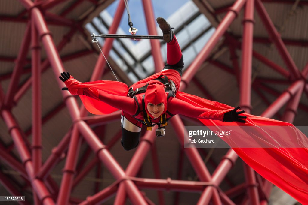 An acrobat abseils from the 114.5 metre high ArcelorMittal Orbit tower at the Olympic Park on April 5, 2014 in London, England. The Queen Elizabeth Olympic Park in east London has opened to the public for the first time since the London 2012 Games. It is the biggest park to be opened in London for a century and it is hoped that the attraction will revitalise the neighbourhood and attract tourists.