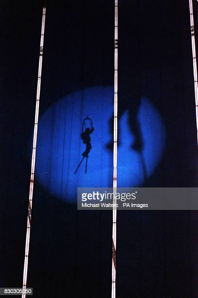 An acrobat goes through their routine on the second of two rehearsal days for the spectacular central area show at the Millennium Dome in Greenwich...
