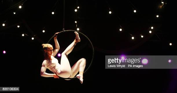 An acrobat performs at the start of the Ashish Catwalk Show at the Hippodrome Leicester Square as part of London Fashion week