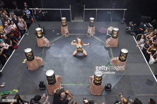 An acrobat performs during a show at The London International Tattoo Convention in Tobacco Dock east London on September 23 2017 / AFP PHOTO / NIKLAS...