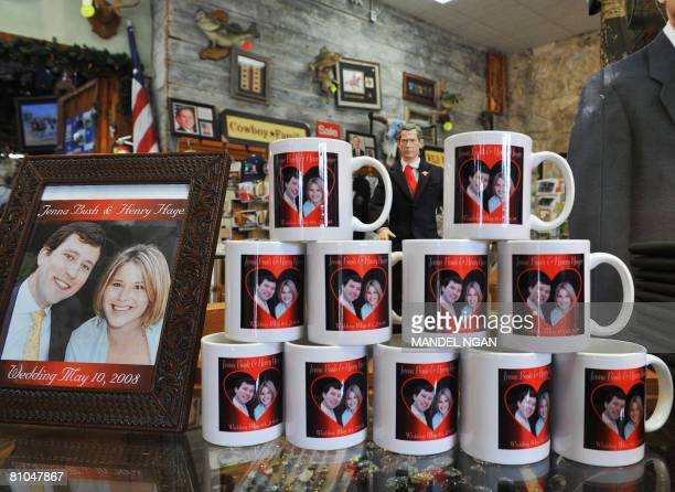 An action figure of US President George W Bush is seen behind coffee cups with the images of Jenna Bush and her fianc Henry Hager at the Yellow Rose...