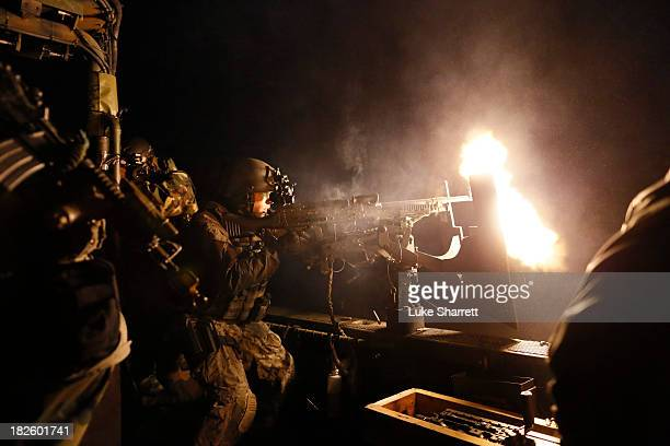 An activeduty Gulf Coast Special Boat Team member's starboard mounted M240 Bravo machine gun spits fire after his boat was ambushed by instructors...