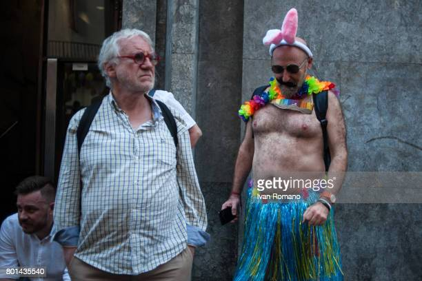 An activist alongside a citizen of Naples who watches the parate in the streets of the city on June 24 2017 in Naples Italy Mediterranean Pride of...