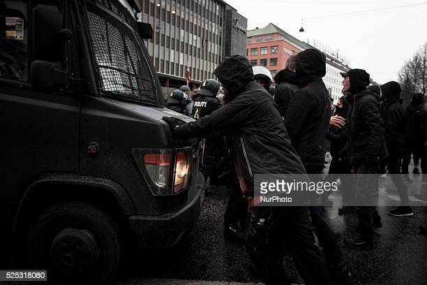 An activist attempt to block a police squad car outside Copenhagen's Vesterport Station Clashes between antiislamist protesters and antifascist...
