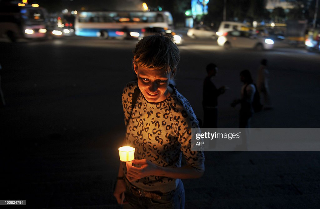 An activist belonging to the Coalition for Sexual Minority Rights (CSMR) takes part in a candlelight vigil held as part of Transgender Day Remembrance held in Bangalore on November 22, 2012. The candle light vigil marks the start of the annual 10-day Bengaluru Pride and Karnataka Queer Habba 2012. AFP PHOTO/Manjunath KIRAN