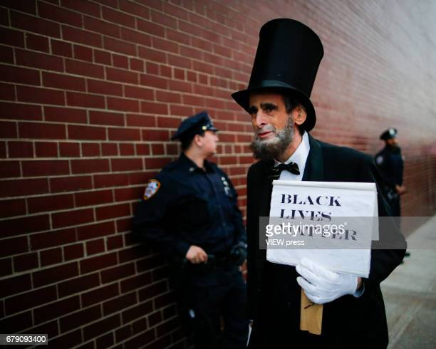 An activist disguised as US president Abraham Lincoln takes part in a protest near the USS Intrepid where US president Donald Trump is hosting the...