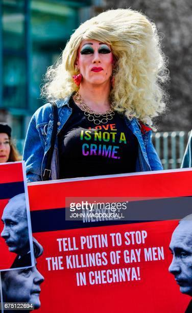An activist displays a placard in front of the Chancellery in Berlin on April 30 during a demonstration calling on Russian President to put an end to...