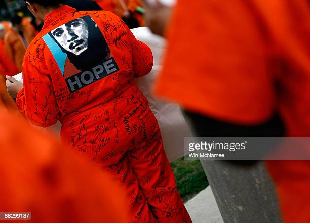 An activist from Amnesty International protests wearing the Obama campaign's HOPE logo near the US Capitol on April 30 2009 in Washington DC The...