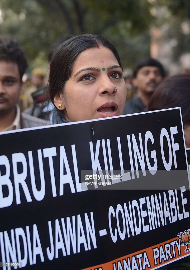 An activist from India's main opposition Bharatiya Janata Party (BJP) holds a placard during a protest march to the Pakistani embassy, against the killing of Indian soldiers Lance Naik Hemraj and Sudhakar Singh in the disputed Kashmir region, in New Delhi on January 9, 2012. India summoned Pakistan's envoy in New Delhi to protest the killing of two soldiers in a border clash, but warned against any escalation, after apparent tit-for-tat skirmishes that have led to deaths on both sides. Two Indian soldiers died after a firefight erupted in disputed Kashmir on Tuesday as a patrol moving in fog discovered Pakistani troops about 500 metres (yards) inside Indian territory, according to the Indian army.