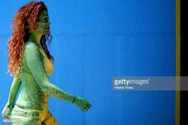 An activist from People for the Ethical Treatment of Animals painted as crocodile demonstrates against the use of crocodile leather in clothing of...