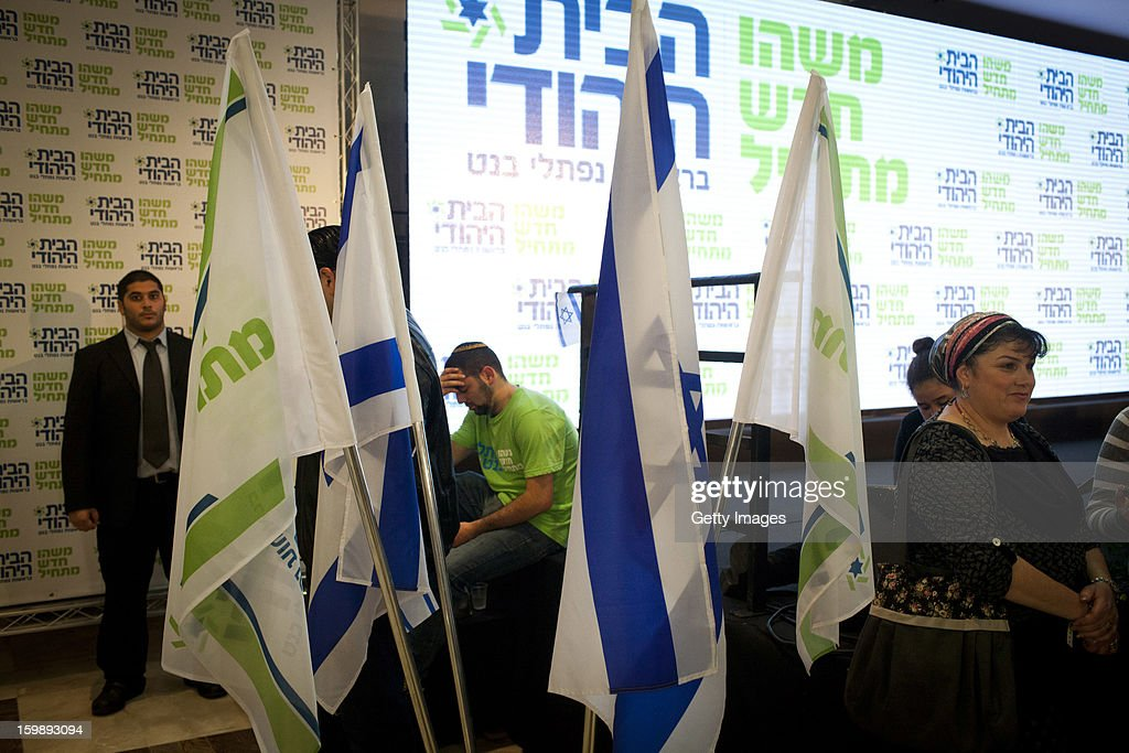 An activist from the Habayit Hayehudi party (The Jewish Home) reacts to the announcement of the first projections on the results of Israel's national elections at a post-election rally on January 22, 2013 in Ramat Gan, Israel. Polls are predicting 12 seats of 120 in the Israeli parliament for the right-wing, religious party led by Naftali Bennett, with Israel seeing the highest turnout of voters since 1999.