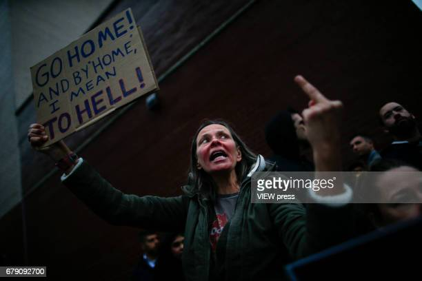 An activist gives a middle finger as she takes part in a protest near the USS Intrepid where US president Donald Trump is hosting the visit of...