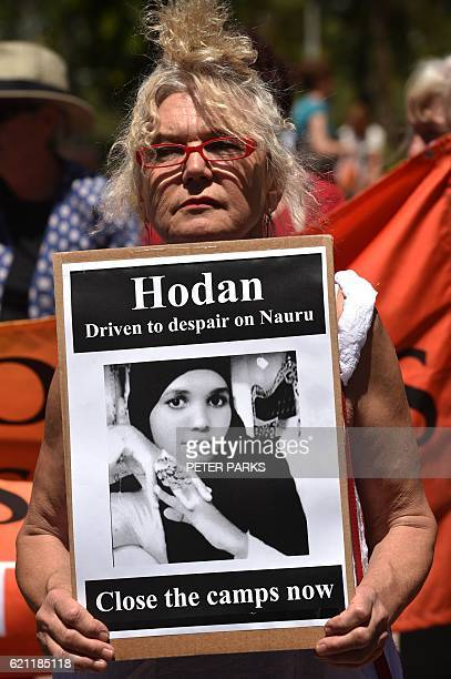 An activist holds a placard in an event organised by Doctors for Refugees to demand humane treatment of asylum seekers and refugees in Sydney on...