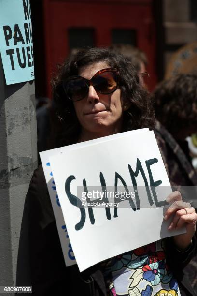 An activist holds a sign as protesters chant slogans against Paul Ryan speaker of the United States House of Representatives visit to Harlem Success...