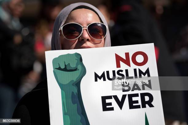 An activist holds a sign during a protest against President Trump's travel ban in Los Angeles California on October 15 2017 The No Muslim Ban Ever...