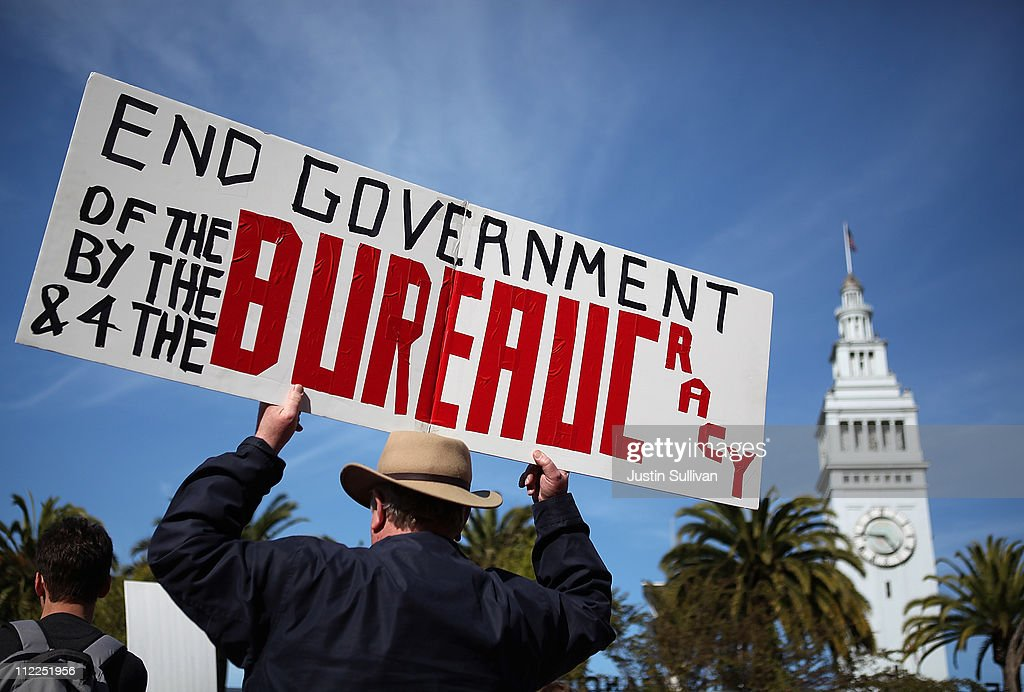 An activist holds a sign during a tax day Tea Party rally on April 15 2011 in San Francisco California Tea Party activists staged tax day rallies...