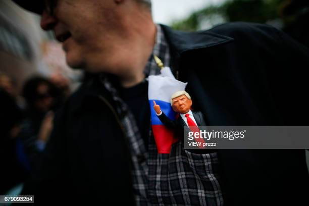 An activist holds a toy of US president Donald Trump as he takes part in a protest near the USS Intrepid where US president is hosting the visit of...