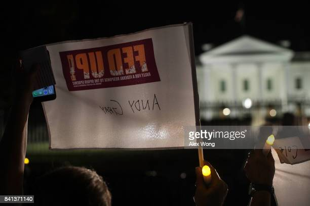 An activist holds up a FED UP flag with the name of a passed loved one in front of the White House August 31 2017 in Washington DC FED UP Coalition...