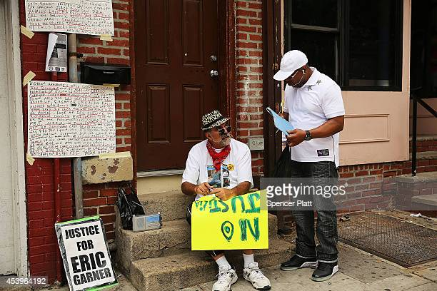 An activist makes signs in preparation for a planned protest and rally against police brutality in memory of Eric Garner August 22 2014 in the...