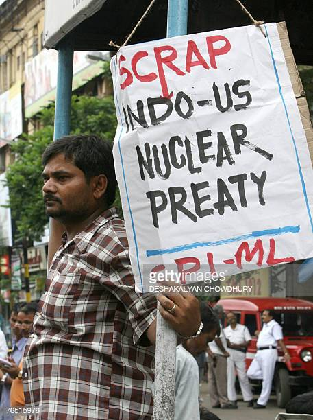 An activist of Communist Party India attends a rally in Kolkata 05 September 2007 against a massive joint naval exercise which kicked off 04...