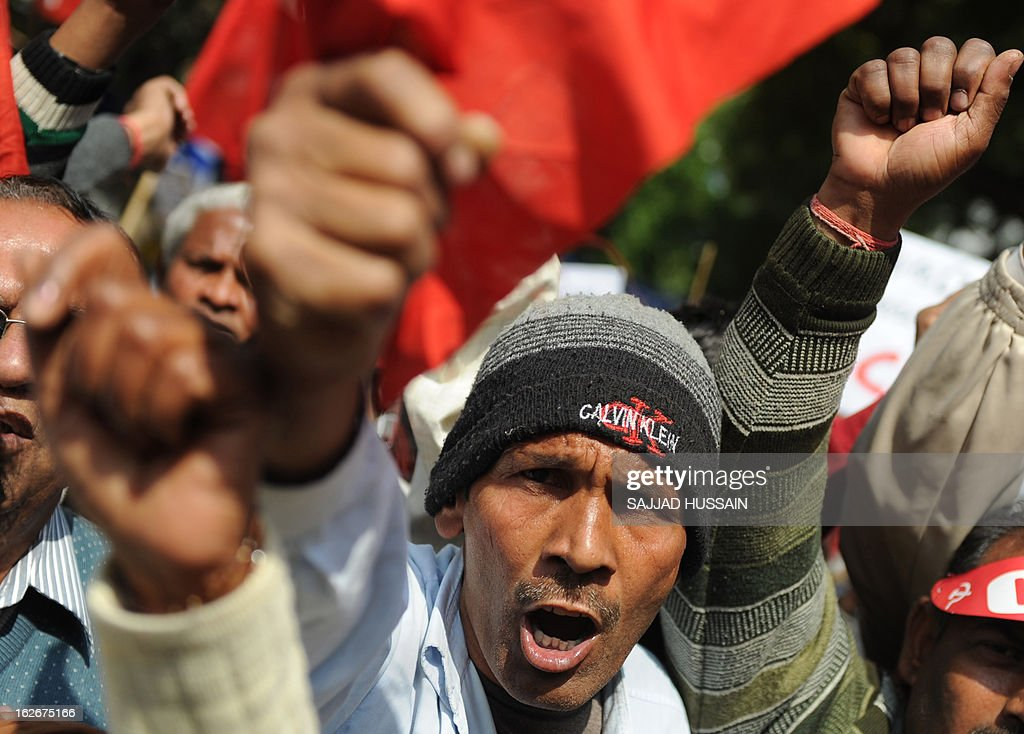 An activist of Communist Party of India(Marxists) shouts slogans during a protest demanding food security in New Delhi on February 26, 2013. Protestors demanded a universal public distribution system, a check on hoarding and black-marketing, an end to future trading and the passage of a food security bill with appropriate amendments to ensure ration to all citizens.