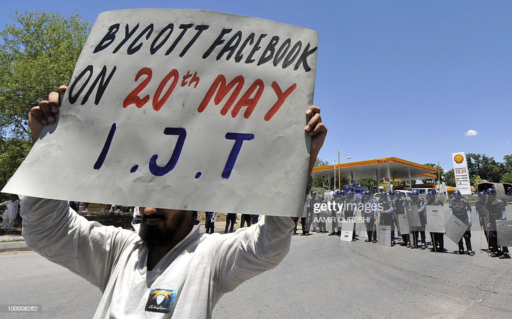 An activist of Islami Jamiat-e-Tulaba (IJT), a student wing of hardline party Jamaat-i-Islami (JI),holds up a placard during a protest in Islamabad on May 20, 2010, against the published caricatures of Prophet Mohammed on Facebook. Pakistan blocked access to the popular video website YouTube in a bid to contain 'growing sacrilegious' material one day after banning Facebook for a similar reason, officials said.