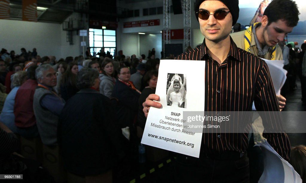 An activist of the association NetzwerkB protests with photographs of victims of sexual abuse of a priest ahead of the speech of Klaus Mertes, director of the Catholic Canisius college during day 3 of the 2nd Ecumenical Church Day (2. Oekumenischer Kirchentag) at International Congress Center (ICC) on May 14, 2010 in Munich, Germany. Thousands will travel to the southern German city to take part in the Church Day events been held from May 12 to May 16, 2010.