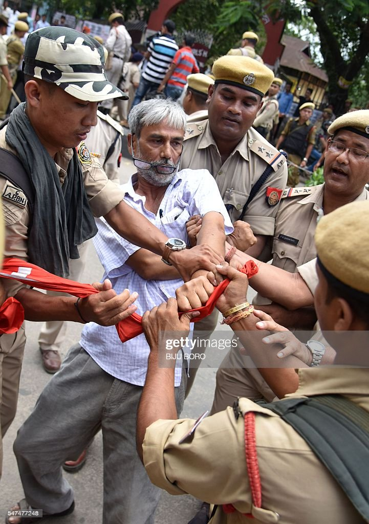 An activist of the Communist Party of India is arrested by police personnel during a protest against the Indian government decision to privatise 12...