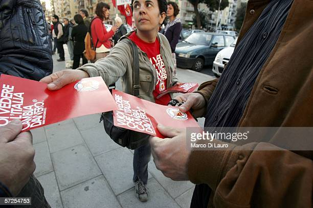 An activist of the Italian political Party Rifondazione Comunista delivers leaflets during an electoral meeting held by Italian transgender candidate...