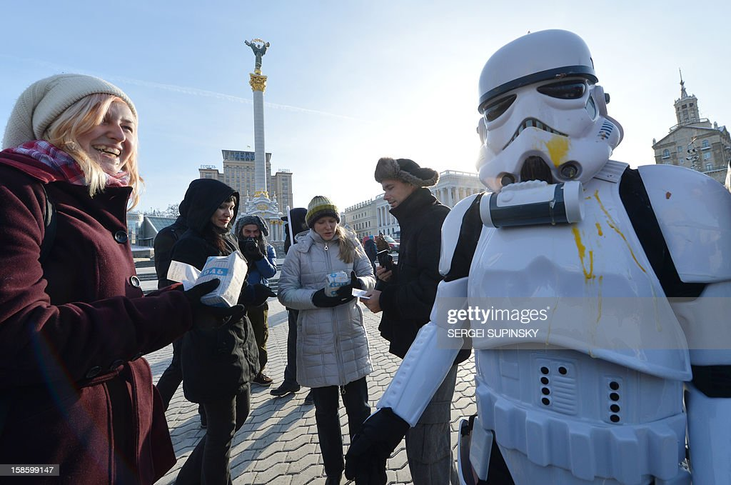 An activist of the Ukrainian Internet Party, wearing a stormtrooper outfit from the Star Wars saga, distributes goods on December 20, 2012 on Independence Square in Kiev. The party activists, who traditionally wear Star Wars costumes during their actions, distributed canned foods, matches, condoms, toilet paper, soap, lightbulbs and 'tickets' for their spacecraft evacuation to passersby to supposedly save Ukrainians from the end of the world on December 21. The date marks the end of an era that lasted over 5,000 years, according to the Mayan 'Long Count' calendar. Some believe that the date, which coincides with the December solstice, marks the end of the world as foretold by Mayan hieroglyphs -- an idea ridiculed by scholars.