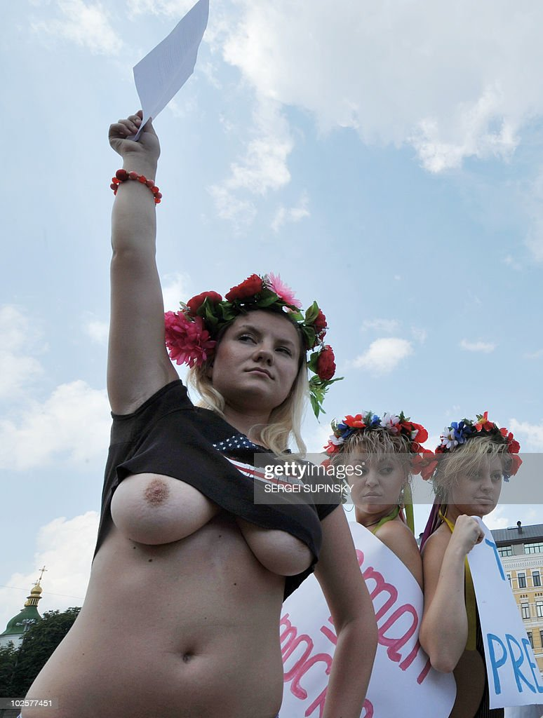 An Activist of Ukrainian women's movement FEMEN holds a letter for Hillary Clinton during their so called topless protest at the Hayat hotel the US...