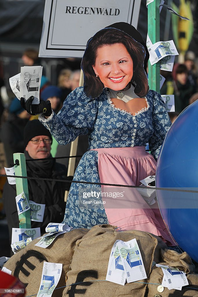 An activist on dressed as an effigy of German Agriculture and Consumer Protection Minister Ilse Aigner joins a march against the agricultural industry on January 22, 2011 in Berlin, Germany. Tens of thousands of demonstrators, including farmers and animal-rights activists, protested against industrial farming techniques, the use of genetically-modified seeds and animals, mass animal husbandry and corporate interest lobbying. The demonstration comes in the wake of a nation-wide dioxin scandal that led to the quarantine of 6,000 farms.