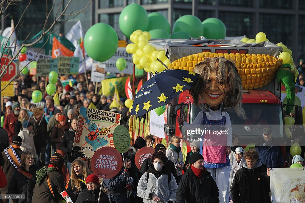 An activist on stilts dressed as an effigy of German Agriculture and Consumer Protection Minister Ilse Aigner joins a march against the agricultural industry on January 22, 2011 in Berlin, Germany. Tens of thousands of demonstrators, including farmers and animal-rights activists, protested against industrial farming techniques, the use of genetically-modified seeds and animals, mass animal husbandry and corporate interest lobbying. The demonstration comes in the wake of a nation-wide dioxin scandal that led to the quarantine of 6,000 farms.