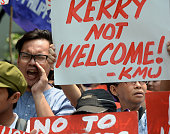 An activist shouts antiUS slogans during a protest at the US embassy to coincide with US Secretary of State John Kerry's visit to the Philippines in...