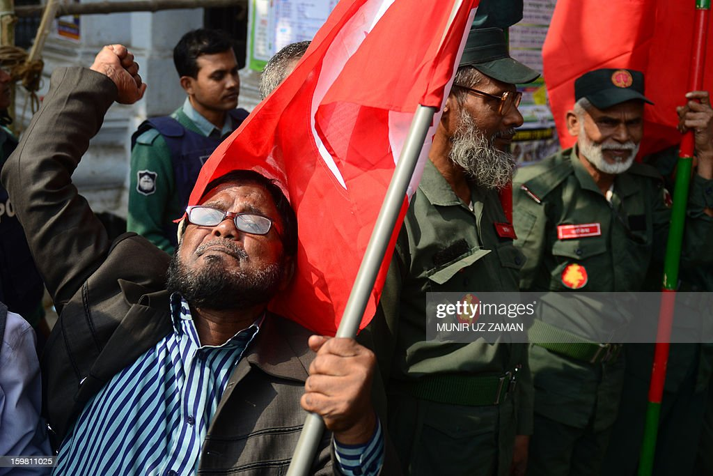 An activist shouts slogans as he and others including former freedom fighters who fought against Pakistan in the 1971 war demonstrate outside the International Crimes Tribunal court premises in Dhaka on January 21, 2013. Bangladesh's controversial war crimes court sentenced to death a top Islamic televangelists for genocide and other atrocities during the country's 1971 liberation struggle against Pakistan, a prosecutor said. Maolana Abul Kalam Azad who has been on the run for about a year is the first person to have been convicted by the controversial International Crimes Tribunal, created by the country's secular government to try suspected war criminals. AFP PHOTO/Munir uz ZAMAN