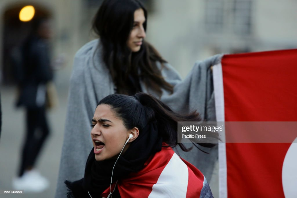 An activist shouts slogans at the protesters. Around 20 Turkish nationalists protested peacefully at Amsterdams Dam square against the decision by the Dutch government to prevent two Turkish politicians to appear at rallies in the Netherlands.