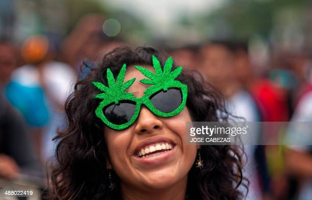 An activist smiles during a march demanding the legalization of marijuana in San Salvador El Salvador on May 3 2014 Social organizations asked the...