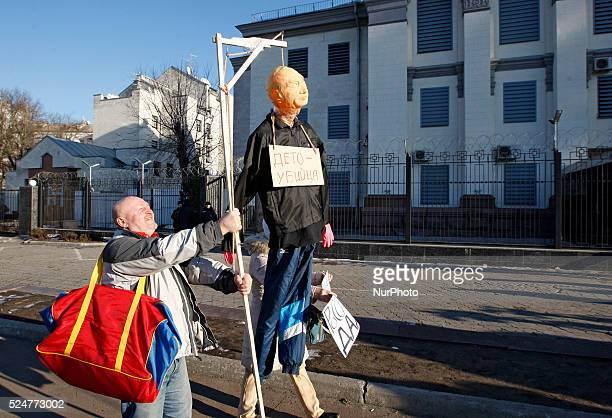 An activist stand with a mannequin depicting President of Russia Vladimir Putinduring a rally against political repression in Russia in front the...