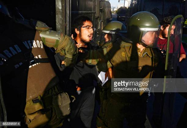 An activist struggles with carabiniere police during a protest against TTP treaties and the Pacific Alliance Ministers' Summit that takes place in...