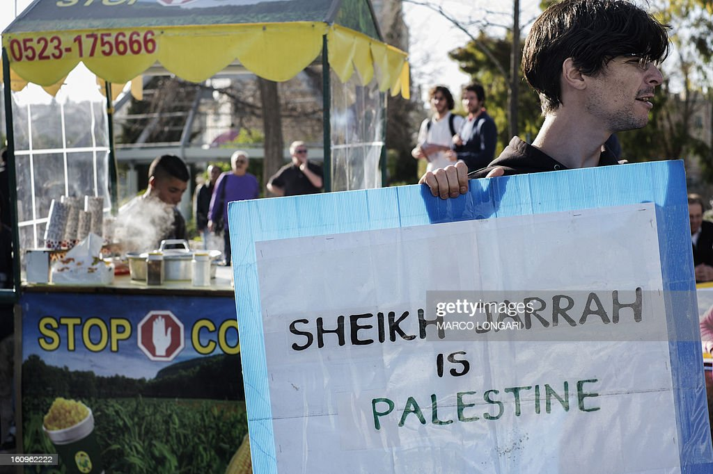 An activist takes part in a demonstration in support of the Palestinian Shamasneh family in the mostly Arab neighbourhood of Sheikh Jarrah in east Jerusalem on February 8, 2013 to protest against an eviction order imposed by an Israeli court that will see the family leaving their home which will be given to a Jewish organisation.