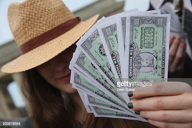 An activist wearing a Panama hat holds fake money while demanding greater trasparency in new legislation following the ongoing Panama Papers affair...