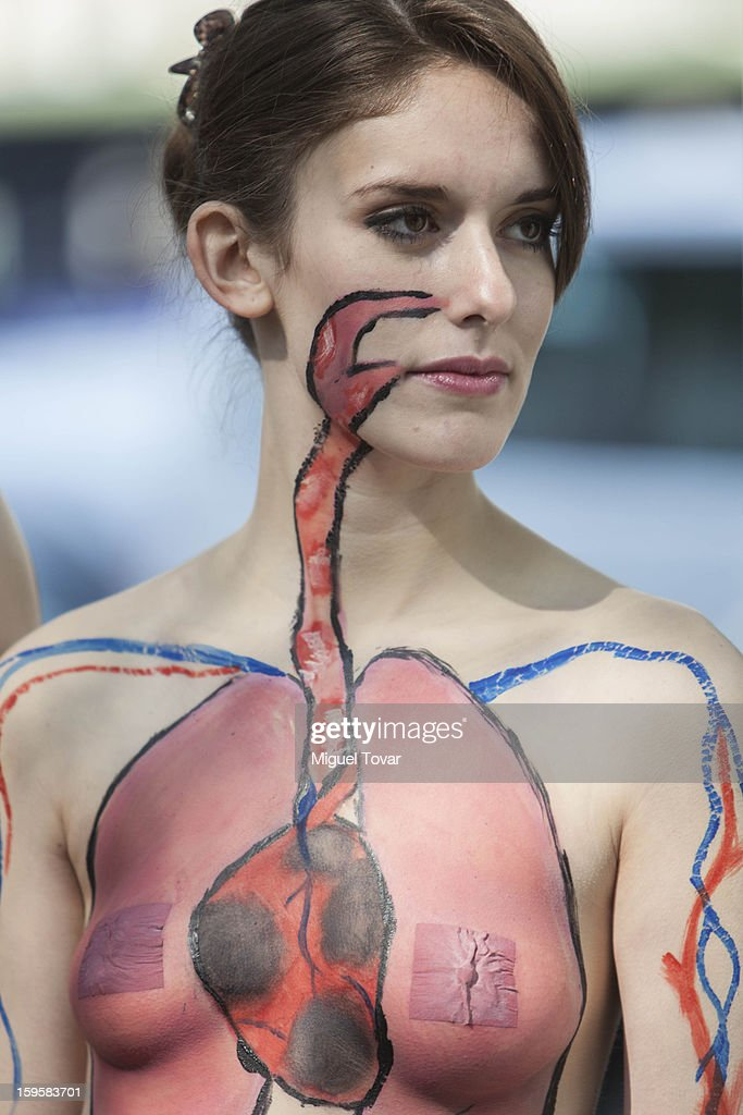 An activist wearing body paint that illustrates her organs damaged from air pollution, protests against the health effects of the city's ongoing pollution problem caused by cars and encouraging residents to use bicycles instead of cars on January 16, 2013 in Mexico City, Mexico.
