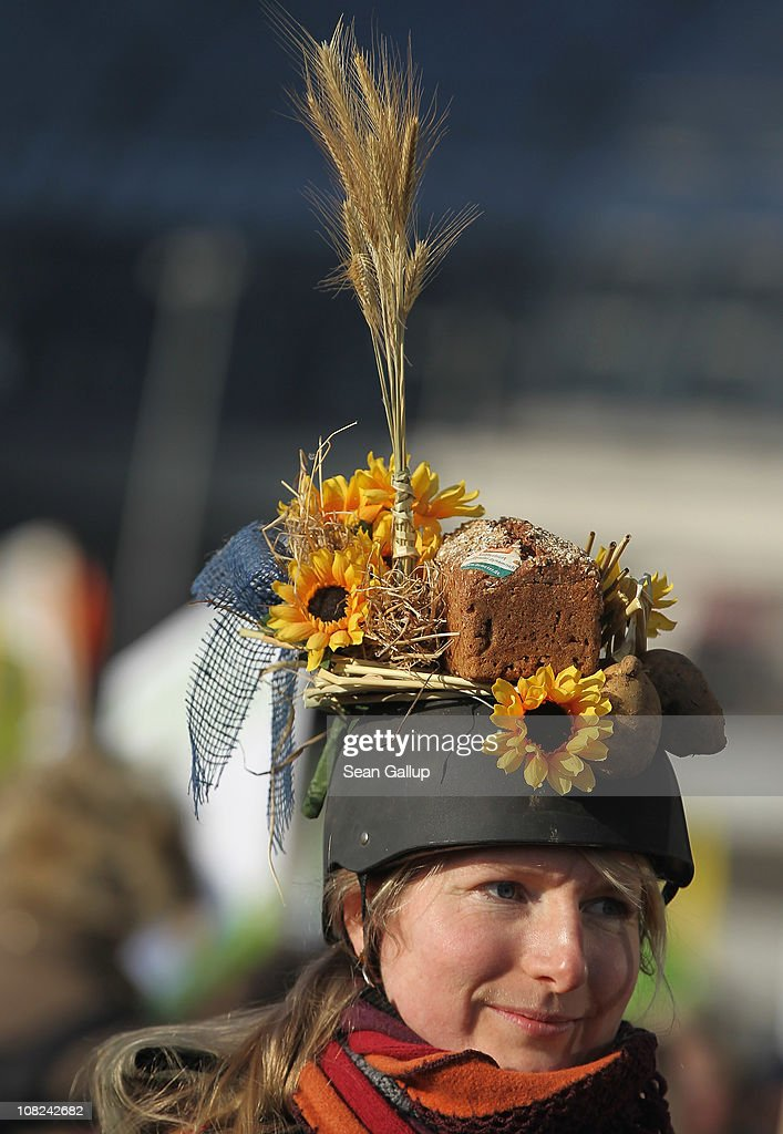 An activist wears a loaf of whole-wheat bread and flowers on her helmet during a demonstration against the agricultural industry on January 22, 2011 in Berlin, Germany. Tens of thousands of demonstrators, including farmers and animal-rights activists, protested against industrial farming techniques, the use of genetically-modified seeds and animals, mass animal husbandry and corporate interest lobbying. The demonstration comes in the wake of a nation-wide dioxin scandal that led to the quarantine of 6,000 farms.