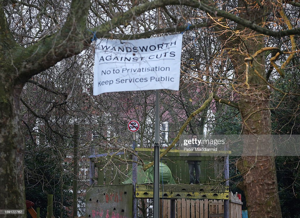 An activist, who is inside the now locked Battersea Park adventure playground, stands next to a tent on January 8, 2013 in London, England. Activists and local residents oppose local authority plans to demolish the adventure playground, which has been mostly used by teenagers, and replace it with facilities for younger children who will need less supervision.